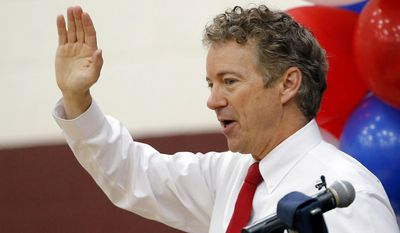 Republican presidential hopeful Sen. Rand Paul, R-Ky., waves to supporters at a rally after speaking at Arizona State University Friday, May 8, 2015, in Tempe, Ariz. (AP Photo/Ross D. Franklin)