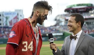 Washington Nationals' Bryce Harper (34) is interviewed after he had chocolate sauce poured on him by teammate Max Scherzer after Harper hit a two-run walk-off home run in the ninth inning of a baseball game against the Atlanta Braves to end the game, Saturday, May 9, 2015, in Washington. The Nationals won 8-6. (AP Photo/Nick Wass)