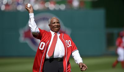Baseball Hall of Famer Frank Robinson throws out the ceremonial first pitch before a baseball game between the Washington Nationals and the Atlanta Braves, Saturday, May 9, 2015, in Washington. (AP Photo/Nick Wass)