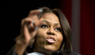 First lady Michelle Obama delivers the commencement address at Tuskegee University, Saturday, May 9, 2015, in Tuskegee, Ala. (AP Photo/Brynn Anderson)