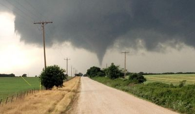 In this Saturday, May 9, 2015 photo provided by Brian Khoury, a tornado touches down in Cisco, Texas. One person was killed Saturday night and another left in critical condition after the tornado hit Cisco, a rural farming and ranch area about 100 miles west of Fort Worth. (Brian Khoury via AP)