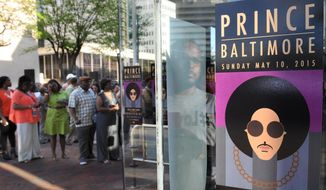 Fans line up outside Royal Farms Arena before Prince's Baltimore concert Sunday, May 10, 2015. (Jerry Jackson/The Baltimore Sun via AP)