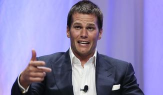 FILE - In a Thursday, May 7, 2015 file photo, New England Patriots quarterback Tom Brady gestures during an event at Salem State University in Salem, Mass. The NFL suspended Brady for the first four games on Monday, May 11, 2015, for his role in a scheme to deflate footballs used in the AFC title game. (AP Photo/Charles Krupa, Pool, File)