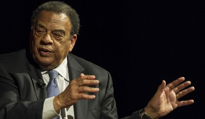 Former U.N. ambassador Andrew Young was taken to a hospital Monday afternoon as a precaution after a cement truck overturned on a car he was riding in, authorities said. (Associated Press)