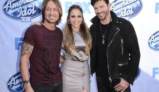 "FILE - In a  Tuesday, Dec. 9, 2014 file photo, from left to right, singer Keith Urban, singer and actress Jennifer Lopez, and singer Harry Connick, Jr. arrive on set of ""American Idol"" in Los Angeles. Fox announced announced Monday, May 11, 2015 that ""American Idol"" will go off the air after its 15th and final season next spring. (Photo by Dan Steinberg/Invision/AP, File)"
