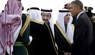 President Obama is greeted by new Saudi King Salman bin Abdul Aziz as the president and first lady Michelle Obama arrive on Air Force One at King Khalid International Airport in Riyadh, Saudi Arabia, on Jan. 27, 2015. (Associated Press) **FILE**