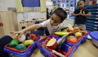 FILE - In this April 2, 2014 photo, Pre-K students educational toys at the South Education Center, in San Antonio. Enrollment in state pre-K programs inched up slightly last year but the overall percent of children participating has remained flat for the last five years and wide disparities remain between states, according to a national study on early education released Monday, May 11, 2015. (AP Photo/Eric Gay, File)