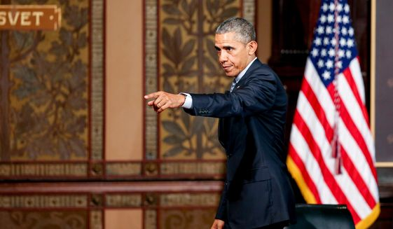 "President Barack Obama points to the audience as he departs after speaking at the Catholic-Evangelical Leadership Summit on Overcoming Poverty at Gaston Hall at Georgetown University in Washington, Tuesday, May 12, 2015.  The president said that ""it's a mistake"" to think efforts to stamp out poverty have failed and the government is powerless to address it.  (AP Photo/Andrew Harnik)"