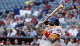 Washington Nationals' Ryan Zimmerman connects on a three-run home run against the Arizona Diamondbacks during the first inning of a baseball game Monday, May 11, 2015, in Phoenix. (AP Photo/Ross D. Franklin)