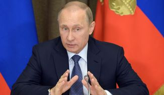 Russian President Vladimir Putin speaks at a meeting with representatives of top military brass and defense industries at the Bocharov Ruchei residence in the Black Sea resort of Sochi, Russia, May 12, 2015. (Associated Press) ** FILE **