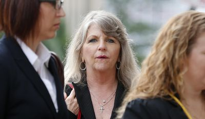 Maureen McDonnell, wife of former Gov. Bob McDonnell, enters 4th U.S. Circuit Court of Appeals for arguments in her husband's public corruption case in downtown Richmond Va., on Tuesday, May 12, 2015. (Mark Gormus/Richmond Times-Dispatch via AP) ** FILE **