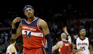 Washington Wizards' Paul Pierce, walks away after a confrontation with Atlanta Hawks' DeMarre Carroll, not pictured, in the third quarter of Game 5 of the second round of the NBA basketball playoffs Wednesday, May 13, 2015, in Atlanta. (AP Photo/John Bazemore)