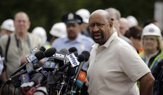 Philadelphia Mayor Michael Nutter speaks at a news conference near the scene of a deadly train wreck, Wednesday, May 13, 2015, in Philadelphia. An Amtrak train headed to New York City derailed and crashed in Philadelphia on Tuesday night killing at least six people and injuring dozens more. (AP Photo/Matt Slocum)