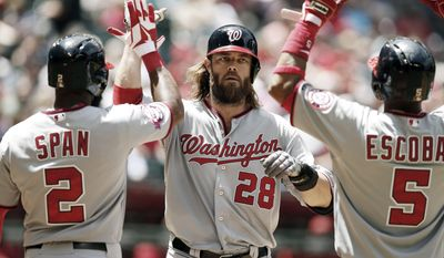 Washington Nationals left fielder Jayson Werth (28) celebrates with Denard Span and Yunel Escobar after hitting a three run homerun against the Arizona Diamondbacks in the third inning during a baseball game, Wednesday, May 13, 2015, in Phoenix. (AP Photo/Rick Scuteri)