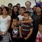 Alexis Marroquin (center, with white T-shirt) was granted a stay to remain in the U.S. while his uncle was sent back to El Salvador. Immigration advocate Ralph Isenberg (back right), who is not an attorney, is taking on the family's crusade to reunite. (Joe De la Fuente)
