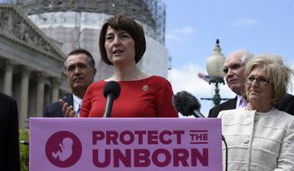 Rep. Cathy McMorris Rodgers, R.-Wash., center, speaks during a news conference on the Pain-Capable Unborn Child Protection Act  on Capitol Hill in Washington, Wednesday, May 13, 2015. (AP Photo/Susan Walsh) ** FILE **