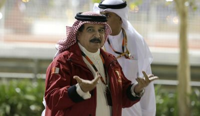 King Hamad bin Isa Al Khalifa of Bahrain arrives to the Bahrain Formula One Grand Prix at the Formula One Bahrain International Circuit in Sakhir, Bahrain, on April 19, 2015. (Associated Press) **FILE**