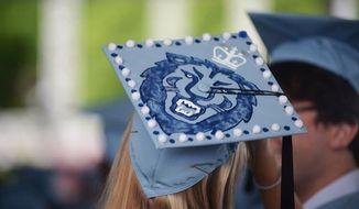 A Columbia University student takes part in her graduation ceremony on May 22, 2014. (Image: Facebook, Columbia University in the City of New York) ** FILE **