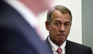 House Speaker John Boehner of Ohio listens during a news conference on Capitol Hill in Washington, Wednesday, May 13, 2015. (AP Photo/Susan Walsh)