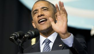 President Barack Obama delivers the commencement address at Lake Area Technical Institute, Friday, May 8, 2015 in Watertown, S.D. Obama visited South Dakota to promote his proposal to offer two years for free community college to qualified students. (AP Photo/{photo})