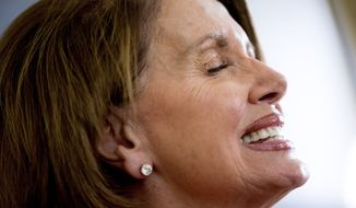 House Minority Leader Nancy Pelosi of Calif., smiles as she speaks to the Associated Press in her office on Capitol Hill in Washington, Wednesday, May 13, 2015. (AP Photo/Andrew Harnik) ** FILE **