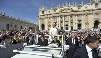 Pope Francis ;eaves at the end of his weekly general audience in St. Peter's Square at the Vatican, Wednesday, May 13, 2015. (L'Osservatore Romano/Pool Photo via AP)