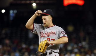 Washington Nationals pitcher Stephen Strasburg adjusts his cap after loading the bases during the fourth inning of a baseball game against the Arizona Diamondbacks, Tuesday, May 12, 2015, in Phoenix. (AP Photo/Matt York)