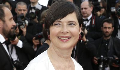 Actress Isabella Rossellini poses for photographers on the red carpet at the opening ceremony and the screening of the film La Tete Haute (Standing Tall) at the 68th international film festival, Cannes, southern France, Wednesday, May 13, 2015. (AP Photo/Thibault Camus)