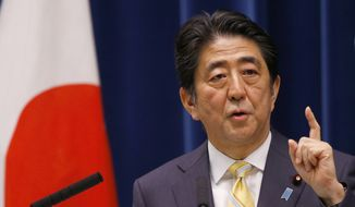 Japan's Prime Minister Shinzo Abe speaks during a press conference at his official residence in Tokyo, Thursday, May 14, 2015. (Associated Press) ** FILE **