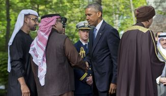 President Barack Obama, center, bids farewell to from left., Abu Dhabi crown prince Sheikh Mohammed bin Zayed Al Nahyan; Bahrain Crown Prince Prince Salman bin Hamad Al-Khalif and Deputy Prime Minister of Oman, Sayyid Fahad Bin Mahmood Al Said after their meetings at Camp David in Maryland, Thursday, May 14, 2015. Obama and leaders from six Gulf nations are trying to work through tensions sparked by the U.S. bid for a nuclear deal with Iran, a pursuit that has put regional partners on edge. Obama is seeking to reassure the Gulf leaders that the U.S. overtures to Iran will not come at the expense of commitments to their security. (AP Photo/Pablo Martinez Monsivais)