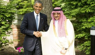 President Barack Obama shakes hands with Saudi Arabia Crown Prince Mohammed bin Nayef after meeting with Gulf Cooperation Council leaders at Camp David in Maryland, Thursday, May 14, 2015. Obama and the leaders from six Gulf nations are trying to work through tensions sparked by the U.S. bid for a nuclear deal with Iran, a pursuit that has put regional partners on edge. (AP Photo/Andrew Harnik)