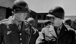 Gen. George S. Patton Jr., left, commander of the U.S. 15th Army, and his chief of staff, Maj. Gen. H.R. Gay, right, are pictured in an undated photo.  (AP Photo)