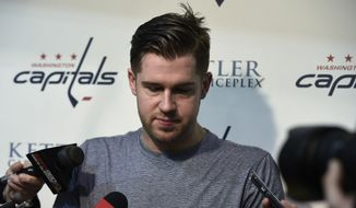 Washington Capitals defenseman Mike Green speaks to reporters at Kettler Capitals Iceplex in Arlington, Va., Friday, May 15, 2015. The Capitals hockey team was eliminated from the Stanley Cup Playoffs and spent the day cleaning out their lockers in preparation for the off season. (AP Photo/Susan Walsh)