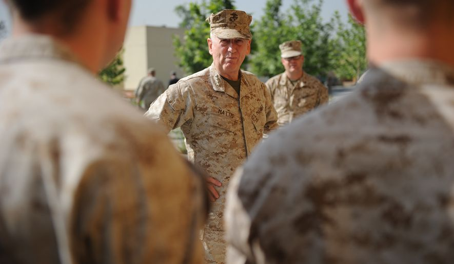 Marines pose with General James Mattis, Commanding General, CENTCOM, at the U.S. Embassy in Kabul, Afghanistan, on Sunday, May 8, 2011.