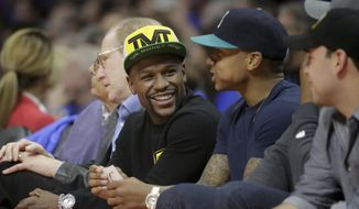 Floyd Mayweather Jr. sits courtside during the first half of Game 6 in a second-round NBA basketball playoff series between the Los Angeles Clippers and the Houston Rockets in Los Angeles, Thursday, May 14, 2015. (AP Photo/Jae C. Hong)