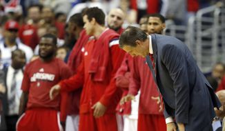 Washington Wizards head coach Randy Wittman reacts in the second half of Game 6 of the second round of the NBA basketball playoffs against the Atlanta Hawks, Friday, May 15, 2015, in Washington. The Hawks won 94-91 to advance to the next round. (AP Photo/Alex Brandon)