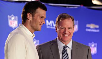 "FILe - In this Feb. 2, 2015, file photo, New England Patriots quarterback Tom Brady, left, poses with NFL Commissioner Rodger Goodell during a news conference where Goodell presented Brady with the MVP award from the NFL Super Bowl XLIX football game. Brady wants to call Commissioner Goodell as a witness in the appeal of the four-game suspension he was handed for ""Deflategate."" (John Samora/The Arizona Republic via AP, File) MARICOPA COUNTY OUT; MAGS OUT; NO SALES"