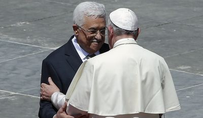 """Pope Francis called Palestinian President Mahmoud Abbas """"an angel of peace."""" The Vatican's recent recognition of Palestinian statehood has drawn fire from neighboring Israel. (Associated Press)"""