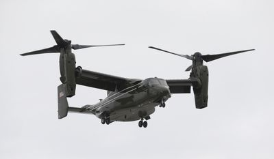 A Marine Corps MV-22 Osprey comes in for a landing at Miami International Airport before a presidential visit, Wednesday, April 22, 2015, in Miami. (AP Photo/Wilfredo Lee)