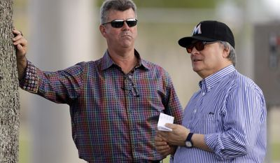 FILE - In this Feb. 20, 2014, file photo, Miami Marlins general manager Dan Jennings, left, talks with Marlins owner Jeffrey Loria during spring training baseball practice in Jupiter, Fla. Marlins general manager Dan Jennings has been chosen the team's new manager, a person familiar with the situation said Monday, May 18, 2015, The person confirmed the move to The Associated Press on condition of anonymity because the decision wasn't announced. (AP Photo/Jeff Roberson, File)