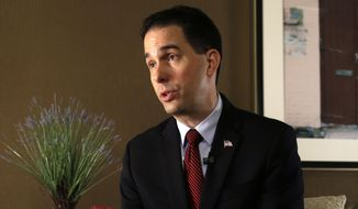 Wisconsin Gov. Scott Walker talks during an interview with The Associated Press in New Orleans, Monday, May 18, 2015. (AP Photo/Gerald Herbert)