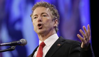 Sen. Rand Paul, Kentucky Republican, said candidates should answer the question about whether, knowing what they know now, they would support the invasion of Iraq, which led to more than 4,000 American troops killed and ongoing turmoil in the region. (Associated Press)