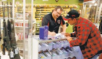 "A man fills out paperwork before selling a handgun to a first-time gun owner at Metro Shooting Supplies, in Bridgeton, Missouri. In 2000, 51 percent of Americans said guns made homes more dangerous, according to Gallup, the polling firm. By last year that had dropped to 30 percent, with a full 63 percent now saying guns made a home ""safer."""