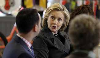 Democratic presidential candidate Hillary Rodham Clinton talks to Brad Magg, left, owner of Goldie's Ice Cream Shoppe and Magg Family Catering, during a meeting with small business owners, Tuesday, May 19, 2015, at the Bike Tech cycling shop in Cedar Falls, Iowa. (AP Photo/Charlie Neibergall)