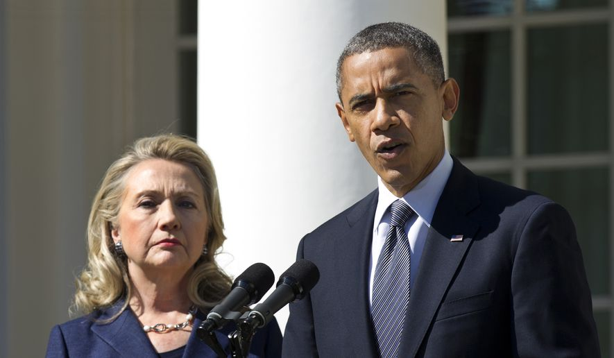 President Barack Obama, accompanied by then-Secretary of State Hillary Rodham Clinton, speaks in the Rose Garden of the White House in Washington, in this Sept. 12, 2012, file photo. (AP Photo/Manuel Balce Ceneta) ** FILE **
