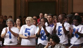 Supporters applaud during the minimum wage increase vote as the Los Angeles City Council votes to raise the minimum wage in the city to $15 an hour by 2020, making it the largest city in the nation to do so, in Los Angeles Tuesday, May 19, 2015. (Associated Press) ** FILE **