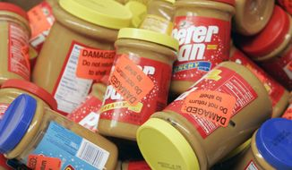 In this Feb. 16, 2007, file photo, returned jars of Peter Pan Peanut Butter are shown at a super market in Atlanta. ConAgra Foods is likely to face a criminal charge now that the U.S. government has completed its investigation of the company's 2007 peanut butter recall. (AP Photo/John Bazemore, File)