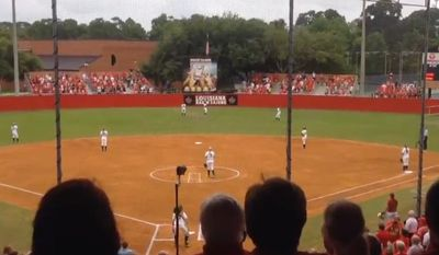 "Fans at the third NCAA Softball Regional game between Louisiana Lafayette and Baylor University sing ""The Star-Spangled Banner"" after being told their wasn't time for the pre-game ceremony, May 17, 2015. (Image: Fox Sports screenshot) ** FILE **"