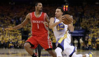 Golden State Warriors' Stephen Curry, right, drives the ball against Houston Rockets' Trevor Ariza during the second half of Game 1 of the NBA basketball Western Conference finals Tuesday, May 19, 2015, in Oakland, Calif. The Warriors won 110-106. (AP Photo/Ben Margot)
