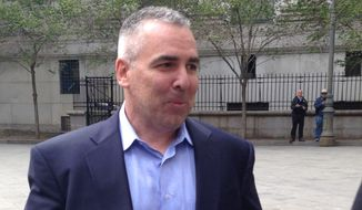 Drug Enforcement Administration telecommunications specialist Glen Glover leaves court in New York, Wednesday, May 20, 2015. were arrested Wednesday on charges they flouted their duties by running a lucrative strip club in New Jersey where prostitution was captured on security video.  (AP Photo/Larry Neumeister)